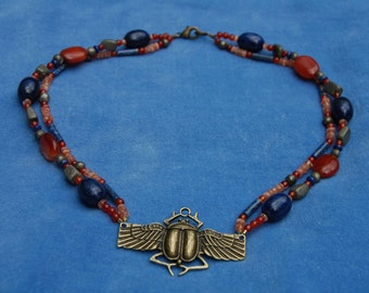 Winged Scarab Two Strand Necklace – khepri – khepera – kemetic – ancient egypt – netjer – lapis lazuli, carnelian, pyrite, and sunstone