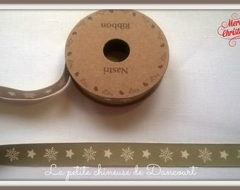 Spool of 3 m tape unbleached snowflakes on gray background