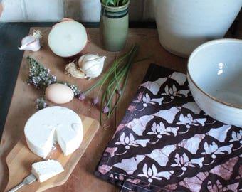 cyclamen tea towel in chocolate brown