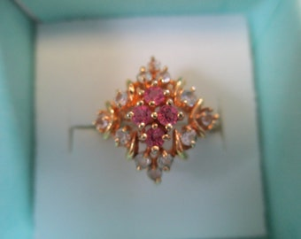Vintage  DAC ring gold toned with pink and  clear crystal faceted stones ,size  6