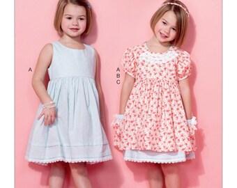 McCall's Sewing Pattern M7375 Children's/Girls' Sleeveless Dress, Puff Sleeve Overdress and Headband