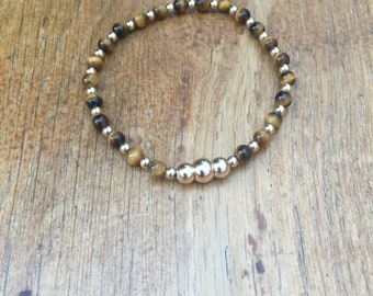 Tiger eye beaded bracelet with 14kt gold filled beads all around with 3 larger centerpiece beads