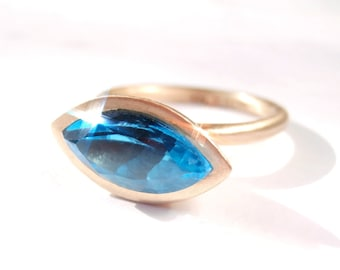 Blue Topaz Gold Vessel ring Navette