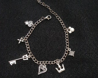 """Kingdom Hearts inspired 7"""" charm bracelet.  Includes seven KH charms"""