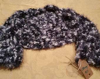 Fun, fuzzy crochet shrug in multiple black, white and silver colors