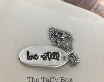 BE STILL silver stamped necklace