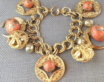 Vintage bauble charm goldtone bracelet from circa 1950's