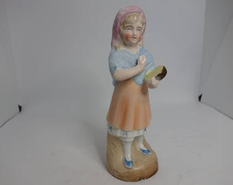 Victorian figure of a country girl playing the tamborine