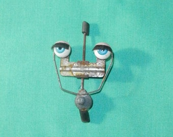 "vintage blue sleepy eyes/plastic 1.47""/0.44""/Germany"
