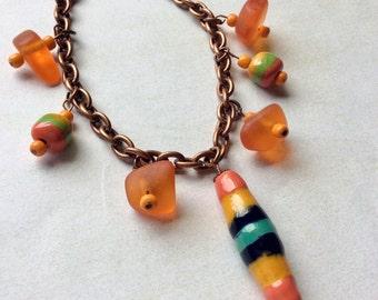 Copper bracelet.Kazuri turban dangle.Resin beads.Orange, buttercup, midnight blue.