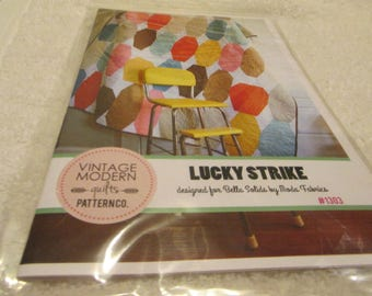 Paper pattern for a quilt called Lucky Strike by Vintage Modern for Moda