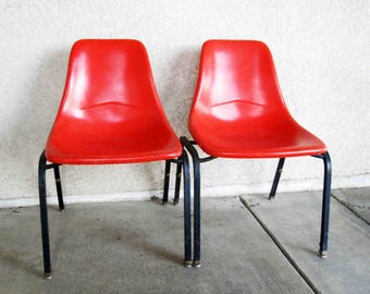 Vintage Set of 2 Mid Century Fiberglass Shell Chairs in Orange. Circa 1950's.