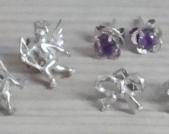 Three pairs of sterling silver stud earrings