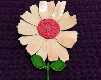 Pink 1960s vintage enamel flower brooch with green stem and leaves
