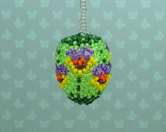 Vintage beaded Easter egg ornament 1960s pansies green purple yellow floral
