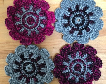 Hand crocheted coasters - pink, black, and silver