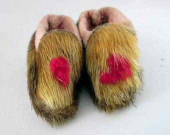 Handmade animal doll slippers.