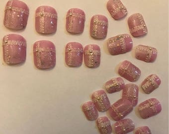 Lacy pink nails