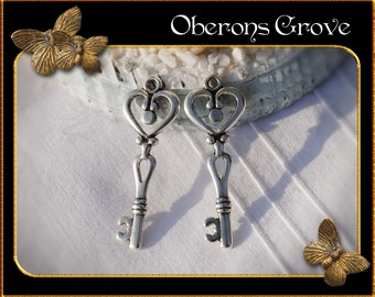 6  key charms silver 42x15mm