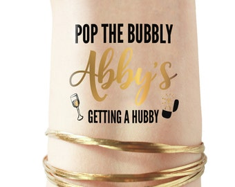 op the Bubbly Im Getting a Hubby Bachelorette Party Tattoos Favors   we got the bubbly, i got the hubby, pop the bubbly i'm getting a hubby