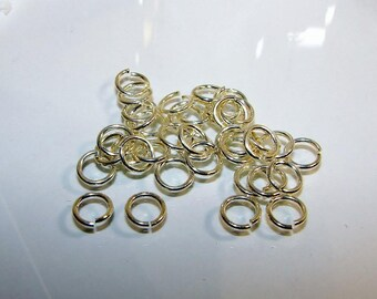 5 grams with rings in bright silver plated brass, 10 microns wire 1.0 mm, diameter 7.2 mm. 2360047