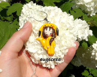 Little girl dressed in yellow animal clay polymer and metal silver necklace