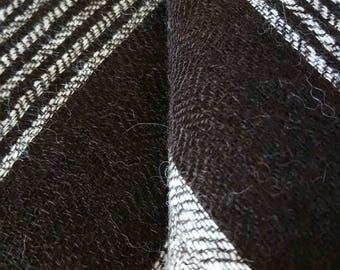 100% Alpaca Hand woven Shawl in black and cream striped design.
