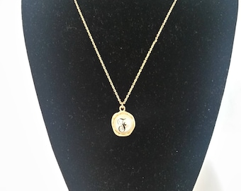 Gold and pearl initial necklace