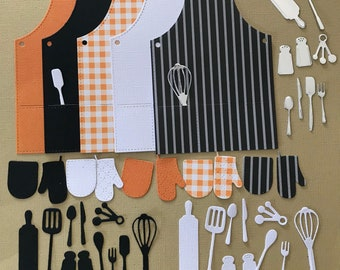 Apron die cuts x 5 with assorted kitchen utensils in black, white and silver.