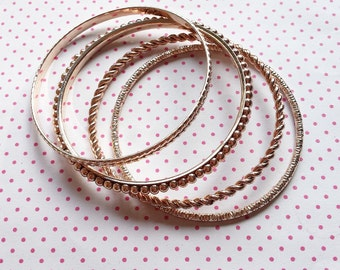 Set of 4 rose gold look bangles free shipping worldwide