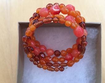 Carnelian gemstone memory wire bracelet, adjustable, vibrant tones, used for healing properties