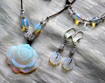 Brown leather necklace with carved opalite rose and moonstones, matching earrings and bracelet.  #NS0094