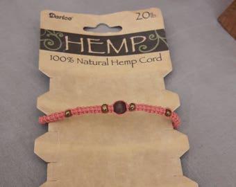 Orange macrame bracelet hand made with hemp.