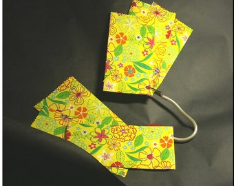 Set of 8 pouches gift to celebrate Easter and spring. Yellow bottoms, printed patterns red and green