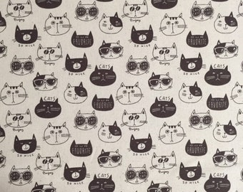 """Cool cats - Black on Natural or White on Black - 100% cotton lightweight canvas - made in Japan - 1/2 yard increments - 44"""" wide"""