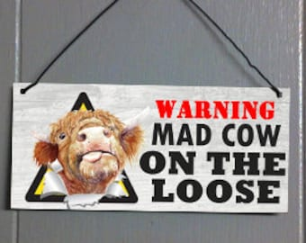 Mad Cow on the loose. Metal hanging sign
