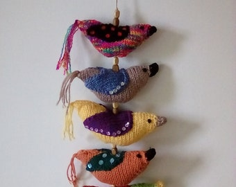 Hand knitted bird mobile