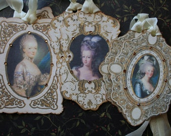 6 Marie Antoinette tags, hand cut framed with rhinestones.