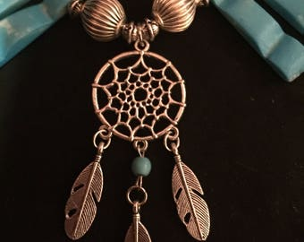 Turquoise stone and tibetan silver necklace with dream catcher pendant