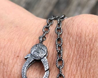 Sterling silver chain with pave diamond lobster claw.