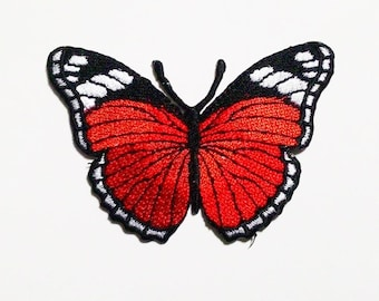 Red butterfly embroidered iron on patch.