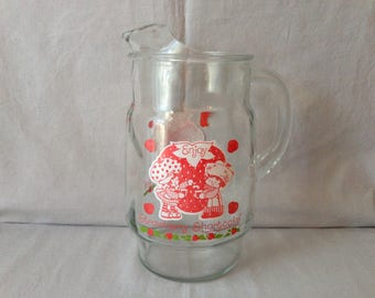 Strawberry Shortcake and Huckleberry Pie Glass Beverage Pitcher 1980 By American greetings