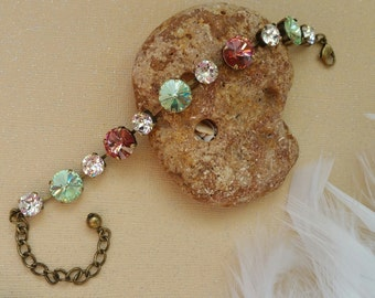 Swavorski crystal bracelet - pink, green and crystal  - crystals set in five 12mm and six 8.5mm  antique gold settings