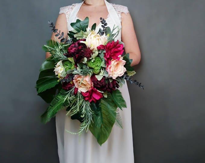 Burgundy, fuchsia and peach tropical flowers wedding bridal bouquet