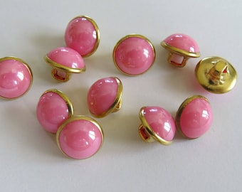 Small domed gold and pale pink round button