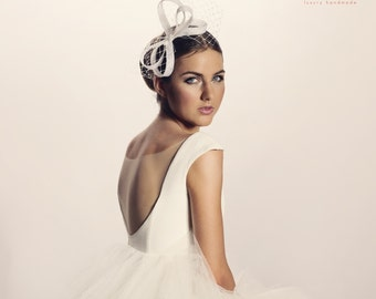 Modern fascinator with french veilig, wedding headpiece, wedding fascinator,wedding bow, wedding veil with spots