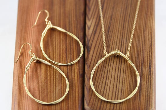 twisted tear drop necklace gold guitar string jewelry. Black Bedroom Furniture Sets. Home Design Ideas