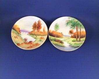 Gold China company Hand painted saucer pair...made in occupied Japan...pastoral/water scenes