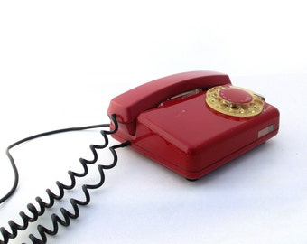 Vintage red rotary telephone from 70s