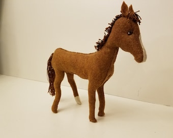 Chestnut horse with customized markings